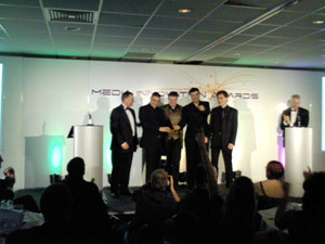 HMC collecting one of their awards